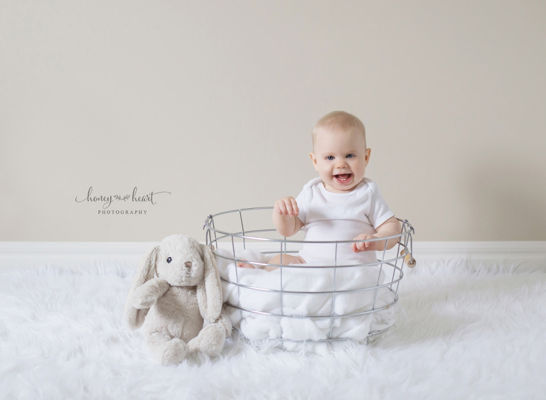 Baby in basket with stuffed toy bunny baby milestone photo session in Calgary Baby Photographers