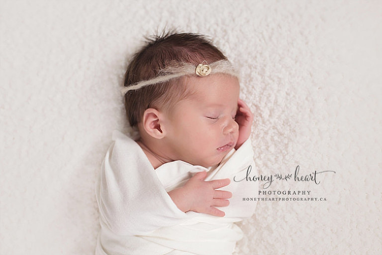 Newborn baby girl posed newborn phographer Calgary AB