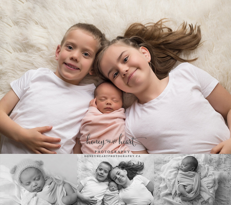 Newborn baby girl posed laying down with two siblings on cream flokati rug