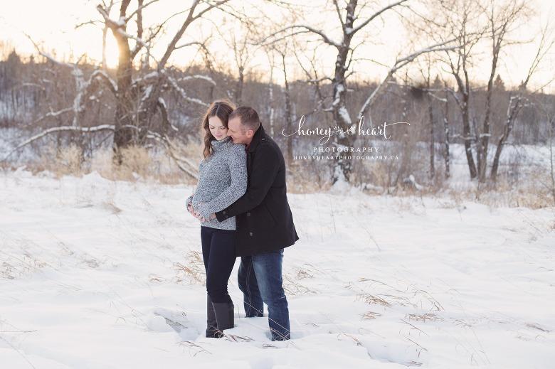 Couple maternity picture winter snow sunset dad hugging mom Calgary Maternity & Newborn Photographers