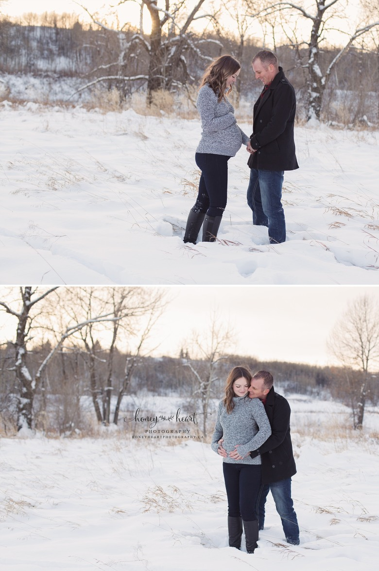 Outside winter maternity session couple facing eachother holding baby belly winter maternity session calgary